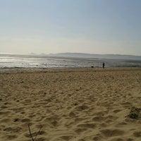 Photo taken at Swansea Bay Beach by Gem T. on 3/26/2012