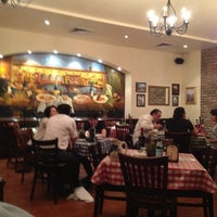 Photo taken at Italianni's Pizza, Pasta & Vino by Yuye M. on 4/6/2012