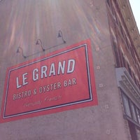 Photo taken at Le Grand Bistro & Oyster Bar by Adam S. on 8/12/2012