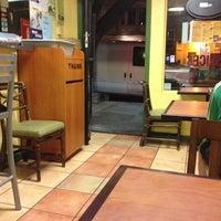 Photo taken at Deja Vu Pizza Restaurant by Kelly . on 8/6/2012