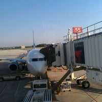 Photo taken at Gate C55 by Melissa S. on 6/2/2012