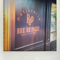 Photo taken at Rue de Passy by Tomo M. on 9/9/2011