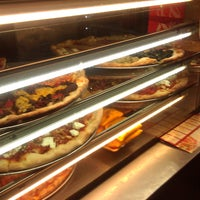 Photo taken at Justino's Pizzeria by Shawn G. on 8/11/2011