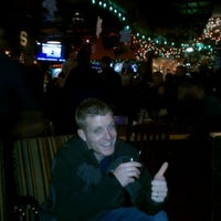 Photo taken at O'Tooles Irish American Grill & Bar by Mark K. on 12/17/2011