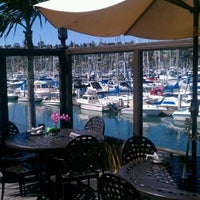 Photo taken at Blue Wave Bar & Grill by Bort R. on 3/8/2012