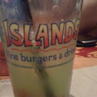 Photo taken at Islands Restaurant by celeste j. on 8/4/2011