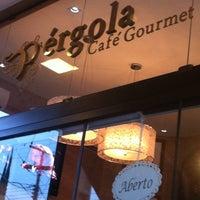 Photo taken at Pérgola Café Gourmet by Erika M. on 4/28/2012