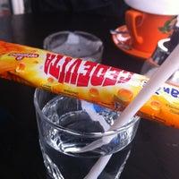 Photo taken at Kiwi Cafe by Vane G. on 11/24/2011
