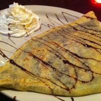 Photo taken at Iguana Café by Humera S. on 4/8/2012
