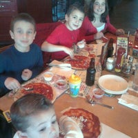 Photo taken at Moretti's Ristorante & Pizzeria by Charlie F. on 12/29/2011