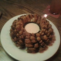 Photo taken at Outback Steakhouse by Melanie P. on 1/16/2012