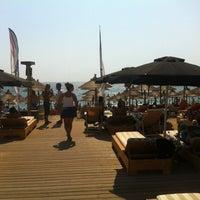 Photo taken at Mango Beach Bar by Argiris T. on 7/20/2012