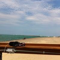 Photo taken at Oak Street Beach Food + Drink by Anne K. on 7/29/2012