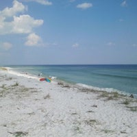 Photo taken at Navarre Beach by Merrie F. on 9/12/2011