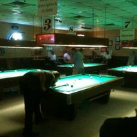Photo taken at Pockets billiards by Kelly Q. on 7/28/2012