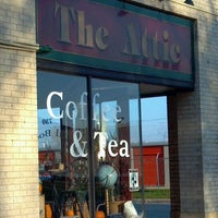 Photo taken at The Attic Books & Coffee by Andrew H. on 11/12/2011