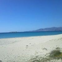 Photo taken at Plaka Beach by DiM P. on 3/4/2012