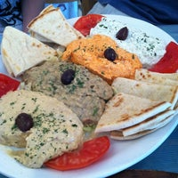 Photo taken at Mykonos Taverna by Amanda T. on 7/28/2012
