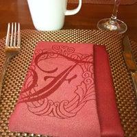 Photo taken at Bambu Restaurant & Lounge by Chuck W. on 3/25/2012
