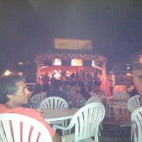 Photo taken at Ocean Annie's Beach Bar by Mac G. on 8/2/2011