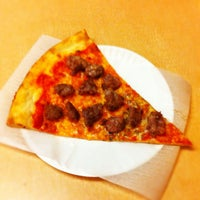 Photo taken at Louie & Ernie's Pizza by Adam K. on 2/1/2012