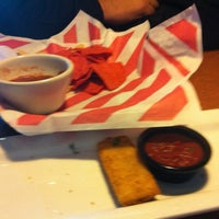 Photo taken at TGI Fridays by A H. on 10/28/2011