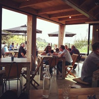 Photo taken at The Piha Cafe by Peter C. on 10/29/2011
