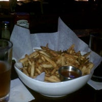 Photo taken at Bowman's Bar and Grill by Eric S. on 9/26/2011