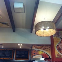 Photo taken at Nando's by Sim on 10/4/2011