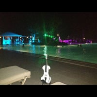 Photo taken at Sani Beach Club by Nikos G. on 8/24/2012