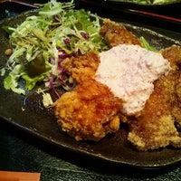 Photo taken at 九州料理と本格焼酎 尊 -MIKOTO- 京橋店 by Kenichiro M. on 12/15/2011
