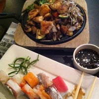 Photo taken at Sushi Roll by Julio P. on 7/21/2011