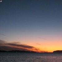 Photo taken at Tralee Beach by destination oban on 8/14/2011