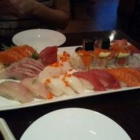 Photo taken at Nu Sushi by J S. on 12/15/2011