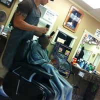 Photo taken at Cornercuts Barbershop by King P. on 7/14/2012