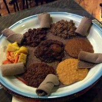 Photo taken at Queen of Sheba Ethiopian Cuisine by LoG S. on 1/13/2012