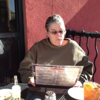 Photo taken at D'amicos Italian Market & Cafe by Kat M. on 12/30/2011