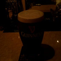 Photo taken at Irish Pub HALF PENNY 西通り店 by guinnessbook on 12/3/2011
