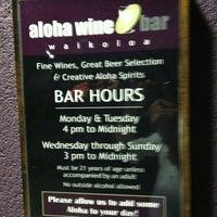 Photo taken at Aloha Wine Bar by Errol R. on 12/9/2011