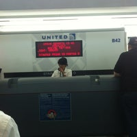 Photo taken at Gate B42 by Rain A. on 6/24/2012