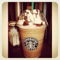 Photo taken at Starbucks by Jessie W. on 7/4/2012