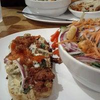 Photo taken at Mia Za's Café by Chrissa K. on 4/23/2012