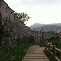 Photo taken at Naksan Park by Seon sik K. on 7/16/2012