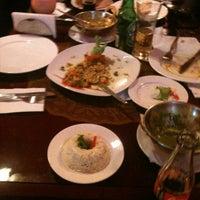 Photo taken at Guru Kebab y Curry by Carlos Augusto L. on 7/21/2012