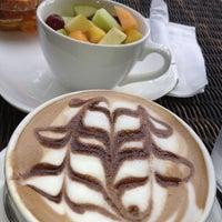 Photo taken at Café Caturra by Adrienne W. on 8/11/2012