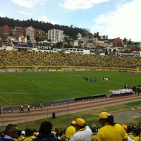 Photo taken at Estadio Olimpico Atahualpa by Lu B. on 9/7/2012