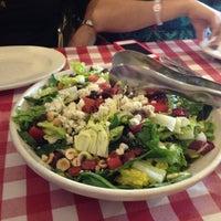 Photo taken at Italianni's Pasta, Pizza & Vino by Mariana M. on 5/19/2012