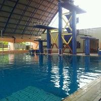 Photo taken at Kompleks Sukan Likas Swimming Pool by Richard L. on 3/18/2012