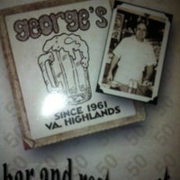 Photo taken at George's Bar & Restaurant by Imaad R. on 7/24/2012