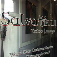 Photo taken at Salvation Tattoo Lounge by Bryce on 8/11/2012
